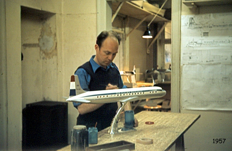 An employee hand painting the model in 1957